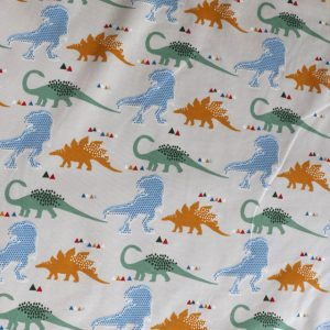 jersey fabric - cream dinosaur print
