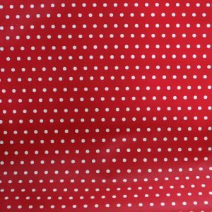 Coated cotton - Red polka dot printed fabric.